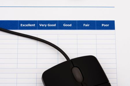 Close up of survey with computer mouse, excellent customer service