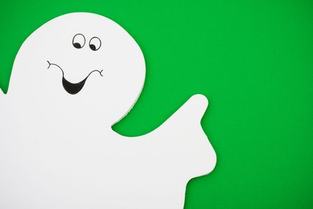 horrify: White ghost on green background with copy space, ghost