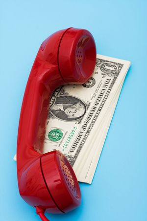 Telephone with money � call for help with your finances