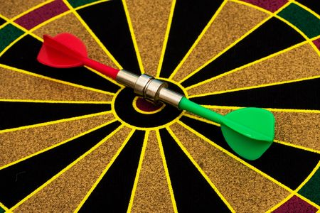 Magnetic dart board with darts � both are on target photo