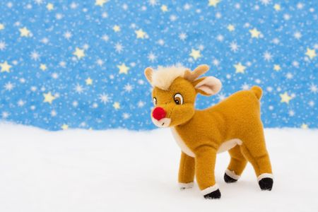 Reindeer in snow on star background, merry Christmas Stok Fotoğraf - 3474226