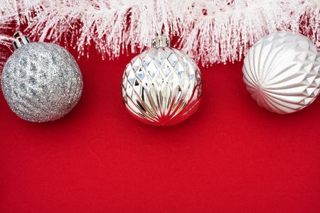 White garland on red background with silver glass balls, Christmas background Stock Photo - 3499661
