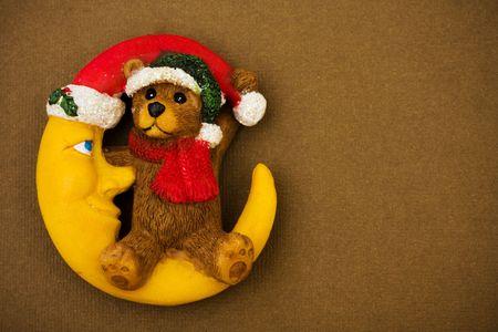 wearing santa hat: Teddy bear sitting on moon wearing Santa hat, Christmas night Stock Photo