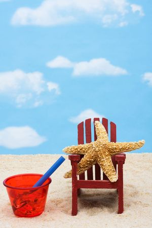 Starfish in an Adirondack chair sitting in the sand on the beach, summer vacation photo