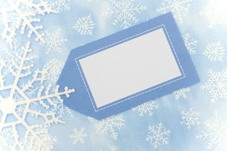 gift tag: Blue background with close up of snowflake making a border with blank gift tag, snowflake border Stock Photo
