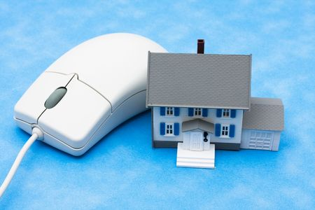 House sitting with computer mouse � online real estate photo