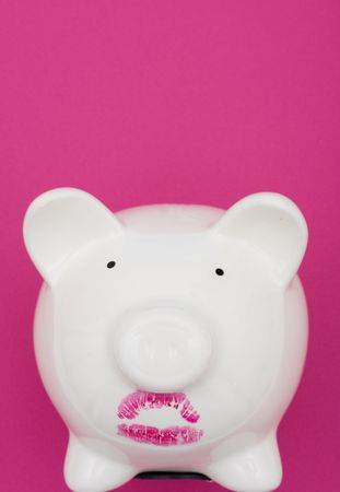 exaggerate: Pink piggy bank wearing red lipstick on pink background, pig wearing lipstick is still a pig