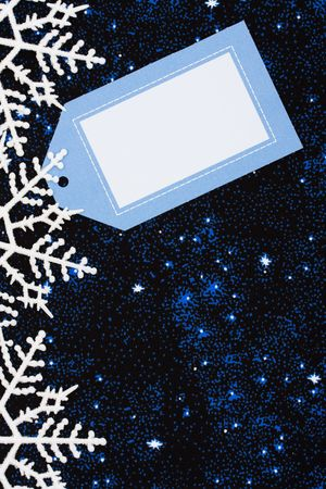 Snowflake border with blank gift tag on star background, snowflake border Stock Photo - 3589804