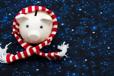 christmas savings: Piggy bank wearing a scarf on star background, Christmas savings