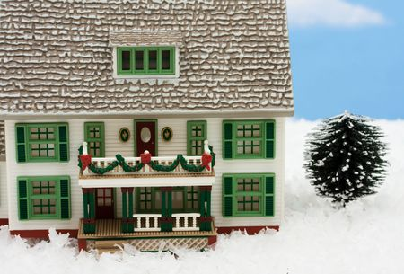 evergreen wreaths: House with Christmas decorations on snow with sky background, merry Christmas