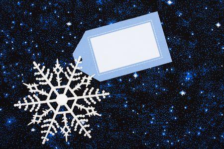 Snowflake border with blank gift tag on star background, snowflake border Stock Photo - 3589824