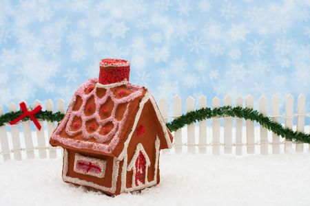 picket green: Gingerbread house and white picket fence with green garland and red bow, merry Christmas