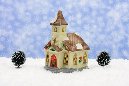 evergreen wreaths: Church with Christmas decorations on snow with snowflake , merry Christmas