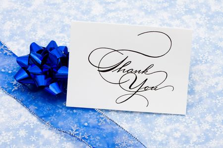 greet card: Thank you card with ribbon and bow on blue snowflake background, thank you card
