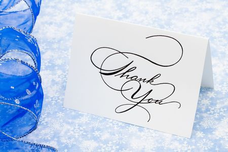 respond: Thank you card with ribbon on blue snowflake background, thank you card