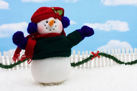 picket green: Snowman and white picket fence with green garland and red bow, merry Christmas