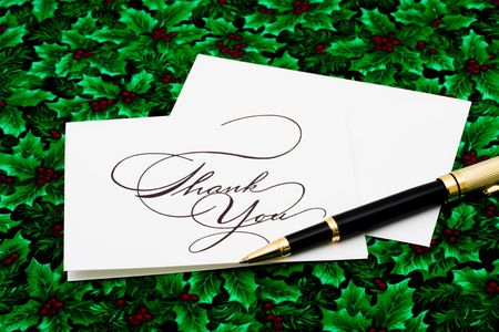 greet card: Thank you card and pen on leaf and holly berry background, thank you card