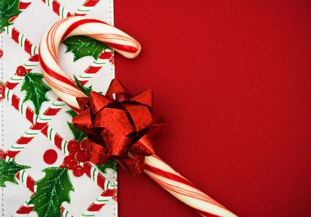Candy cane, holly berries and leaf border on red background, Christmas border Stock Photo - 3745837