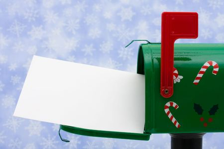 Green mailbox with blank card and the flag up with a snowflake background, mailbox
