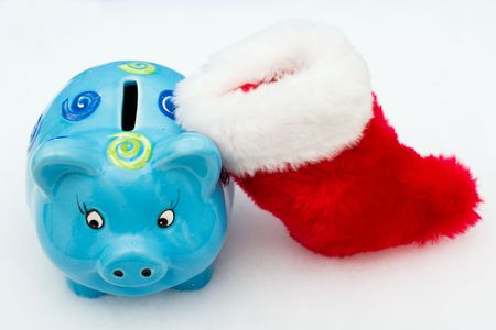 christmas savings: Piggy bank and red stocking on white background, Christmas savings Stock Photo