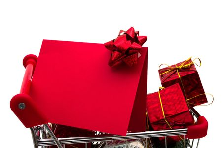 Shopping cart filled with presents and blank gift tag and red bow on white background, Christmas shopping Stock Photo - 3857521
