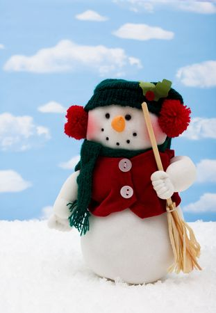 Snowman wearing scarf on sky background, merry Christmas  photo