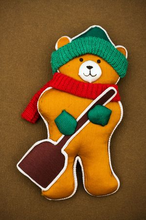 A winter themed bear on brown background, winter bear