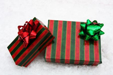 Two Christmas presents sitting on snow background, Christmas presents Stock Photo - 3922109