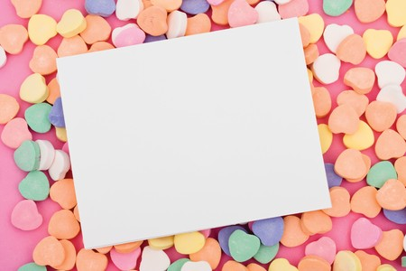 Blank paper on candy heart background