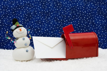 Red mailbox with envelope inside with a snowman on snowflake background, mailbox photo
