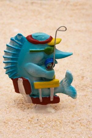 sand shark: Shark in a chair with sand and a seashell. Gone fishing
