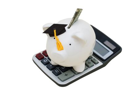 Piggy bank with dollar bill, wearing a graduation cap and calculator on white background, education savings. Stock Photo - 4607426