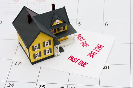 overdue: An overdue bill beside a house on calendar background, overdue mortgage