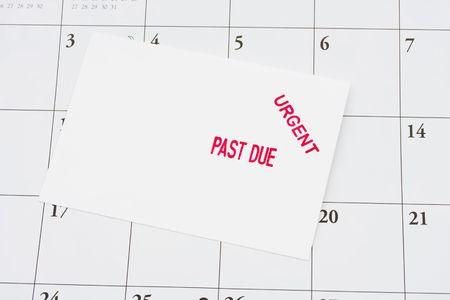 overdue: An overdue bill on a calendar background, overdue bills