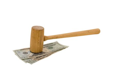 Wooden gavel sitting on three twenty dollar bills, isolated on white background, judgement money