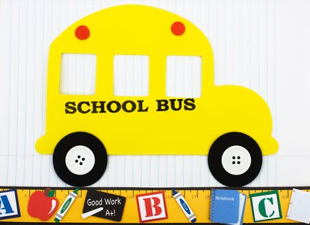 A yellow school bus with a ruler sitting on a paper background, School days photo