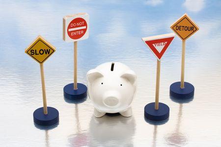 kockázatos: Piggy bank sitting next to a road signs, risky investments