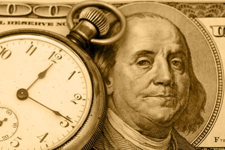 A stopwatch sitting on one hundred dollar bill background, time is money photo