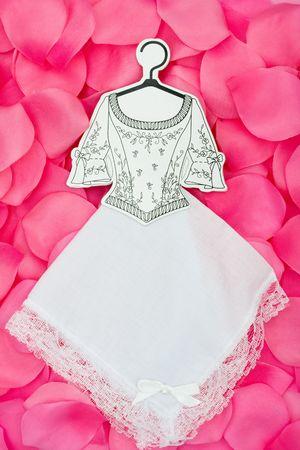 Paper wedding dress on a flower petal background, wedding dress