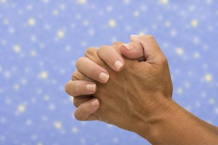 Two hands  n a star background, praying  photo