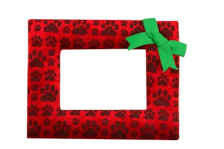 A red and black paw print border with a green bow isolated on a white background, paw print border photo