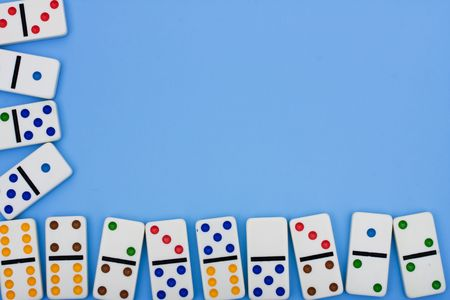 A border made of dominoes sitting on a blue background, domino border