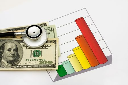 healthcare costs: A one hundred dollar bill and stethoscope on a graph that is on a white background, increased healthcare costs Stock Photo
