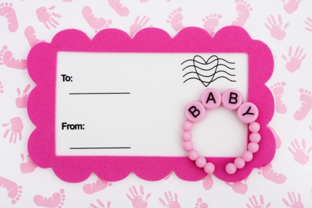 A white postcard with a pink border and baby bracelet on a hand and footprint background, baby shower invitation photo