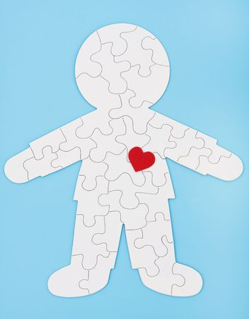 puzzling: A white puzzle in the shape of a human body on a blue background, puzzling body