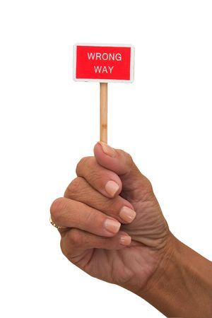 wrong way sign: Hands holding a red wrong way sign isolated on a white background, wrong way