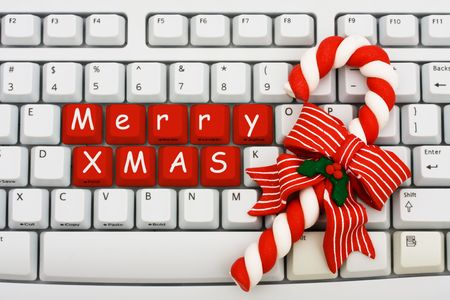keyboard keys: A keyboard saying Merry Xmas and a candy cane, Christmas shopping on the internet