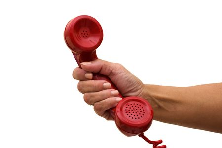 A hand holding a red handset of a telephone, answering the telephone photo