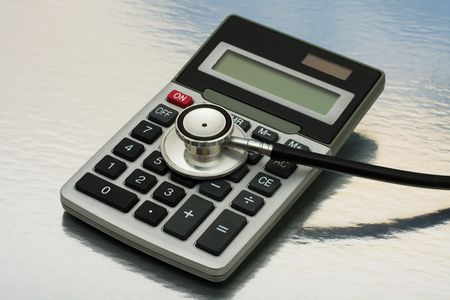 healthcare costs: A calculator and stethoscope isolated on a shiny background, calculating healthcare costs
