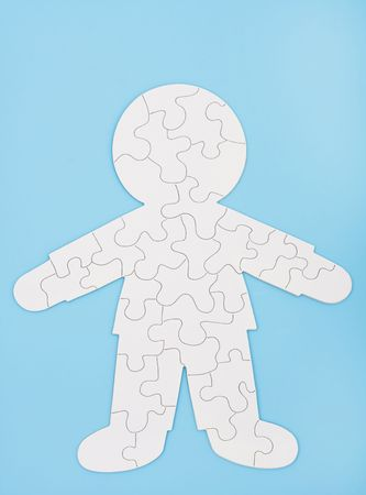 A white puzzle in the shape of a human body on a blue background, puzzling body